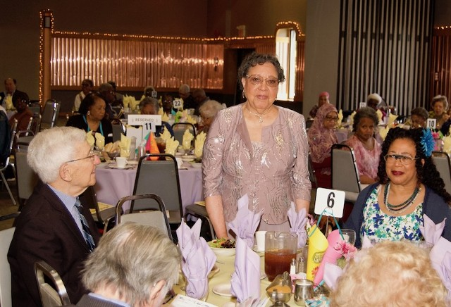 Woman Standing At Table 6