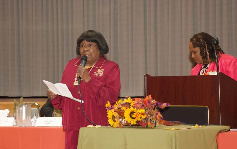 Woman Wearing Red Clothes Giving Speech