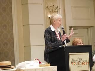 Woman In Coat Giving Speech