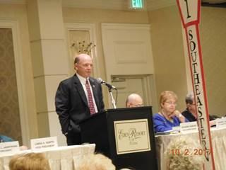 Man In Coat Giving Speech 2
