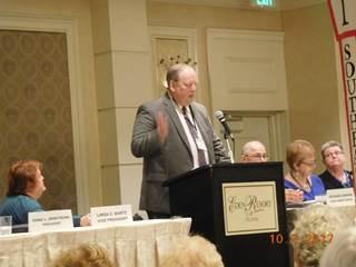 Man In Coat Giving Speech