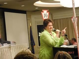 Woman In Green Dress Giving Speech