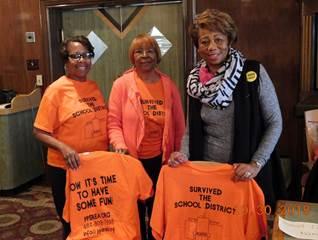 Women Holding Orange T-Shirts